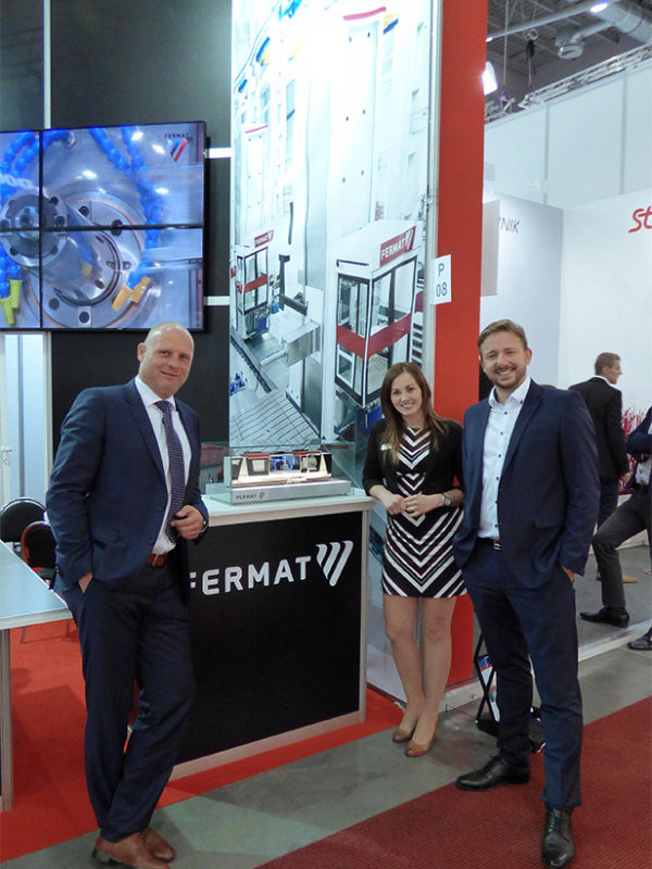 Ing. Michal Bures, MBA, Vaclav Chvatlina and Mgr. Jana Skacelova standing by the special model CNC grinder BHM at the fair MSV | IMT 2016 in Brno